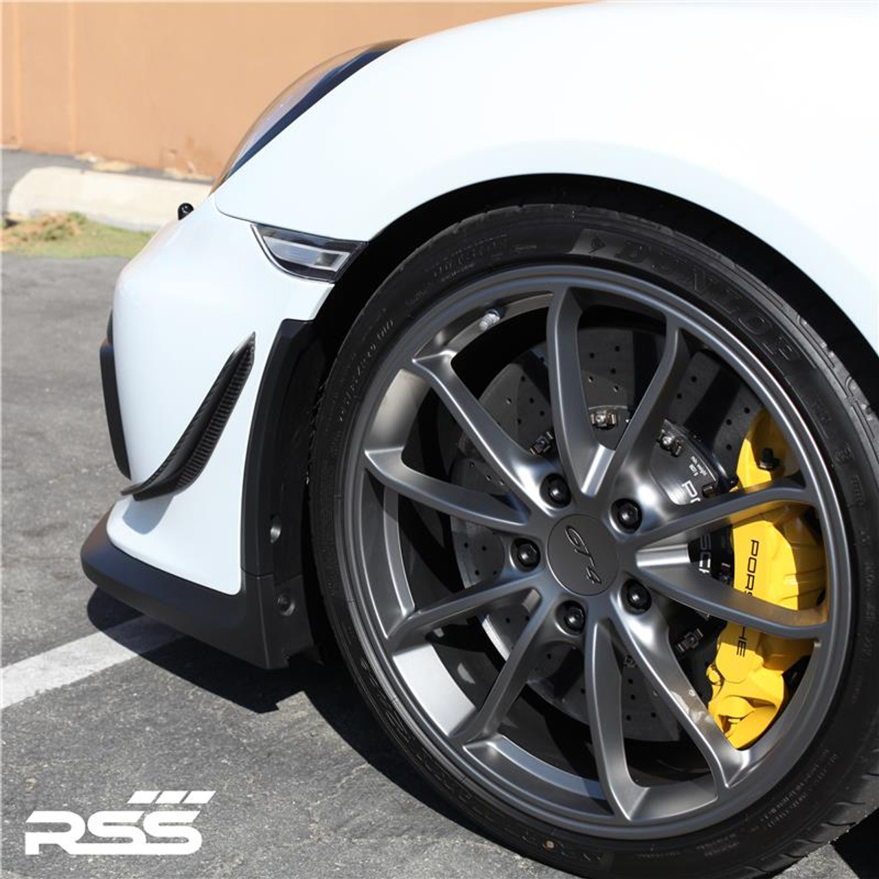 RSS - CarbonAero Kit # 251 for 981 GT4 and 981 Spyder. Includes pair of FRONT CANARDS / DIVE PLANES, Aesthetically pleasing and aggressive in appearance, Canards have a functional purpose with direct benefits on street and motorsports applications. Designed with the latest CAD technology, constructed to exacting standards with pre-preg 2×2 Carbon Fibre Twill, finished in Matte Clear Coat with UV inhibitors, adhere with 3M VHB tape for easy application and removal, and are 100% Manufactured in USA. Components are of the highest quality and are guaranteed to fit.• Produce down force by deflecting oncoming air upward resulting in a net down force on the front of the vehicle • Can direct air towards other important aero devices or cooling vents • Direct air away from the wheels and tires thereby reducing drag, turbulence and lift • Can be used to balance and tune front to rear down force levels.