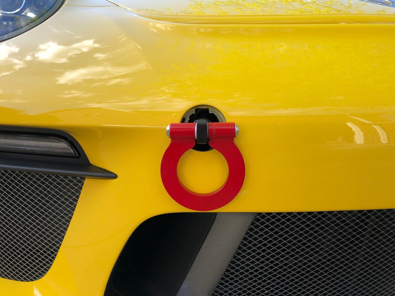 "RSS Tow Hooks for Porsche Automobiles. Designed, engineered and manufactured in USA. High quality and functionality for your Porsche. RSS Folding Tow Hooks for Porsche Models are engineered with a 90 Degree Angle Stop Design and with Adjustable Bumper Offset to prevent bumper cover contact. Made in USA at RSS. Easy to Install, Screws Into Factory Location; Black 1018 Steel Shaft w/Stainless Steel Hoop; Angle of Hoop is Adjustable; 2"" Opening; Utilizes Special Factory Porsche Thread Style; 991.2 GT3/RS and Turbo: BLACK (#941/30), and RED (#941/34)."