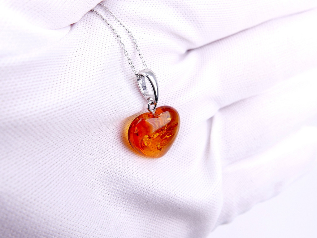 Baltic amber heart pendant / sterling silver bail