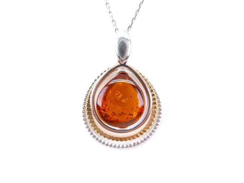 Silver tear drop shape Baltic amber pendant