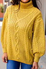 mustard-cable-knit-pom-sweater.jpg