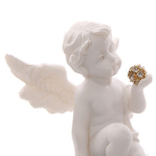 Cherub Sitting on Large Heart