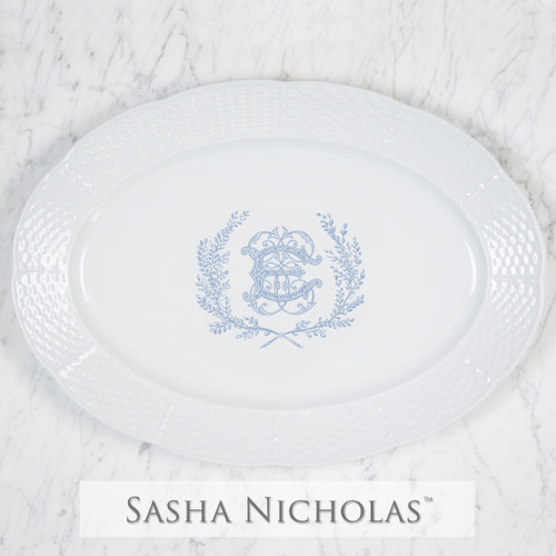 A beautiful addition to your dinnerware collection and to adorn your tablescapes with. It makes the perfect gift for your wedding registry and has the option to include an inscription on back. Choose from their signature font styles or use a custom monogram or crest of your choice! | Sasha Nicholas's white porcelain weave oval platter