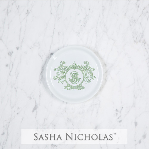 A beautiful addition to your dinnerware collection and to adorn your tablescapes with. It makes the perfect gift for your wedding or gift registry. Choose from their signature font styles or use a custom monogram or crest of your choice! | Sasha Nicholas's white porcelain coaster