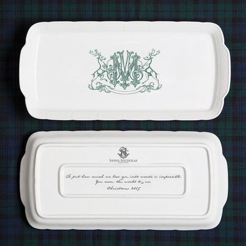 A beautiful addition to your dinnerware collection and to adorn your tablescapes with. It makes the perfect gift for the holidays with the included handwritten inscription on back. The pine green stag crest is a holiday classic. | Sasha Nicholas's white porcelain hostess platter