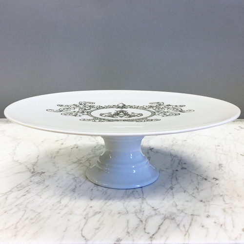 A beautiful addition to your dinnerware collection and to adorn your tablescapes with. It makes the perfect gift for your wedding registry with the included inscription on bottom. The Fleur De Lis Crest is a stunning classic. | Sasha Nicholas's white porcelain cake plate