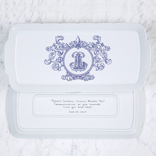 A beautiful addition to your dinnerware collection and to adorn your tablescapes with. It makes the perfect gift for your wedding registry with the included handwritten inscription on back. The Fleur De Lis Crest is a stunning classic. | Sasha Nicholas's white porcelain hostess platter
