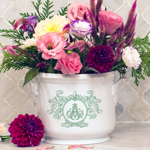 A beautiful addition to your dinnerware collection and to adorn your tablescapes with. It makes the perfect gift for your wedding registry with the included handwritten inscription on back. The Fleur De Lis Crest is a stunning classic. | Sasha Nicholas's white porcelain champagne bucket