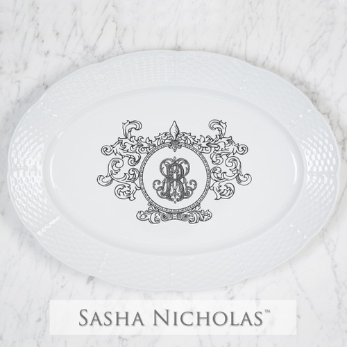 A beautiful addition to your dinnerware collection and to adorn your tablescapes with. It makes the perfect gift for your wedding registry with the included inscription on back. The Fleur De Lis Crest is a stunning classic. | Sasha Nicholas's white porcelain oval platter