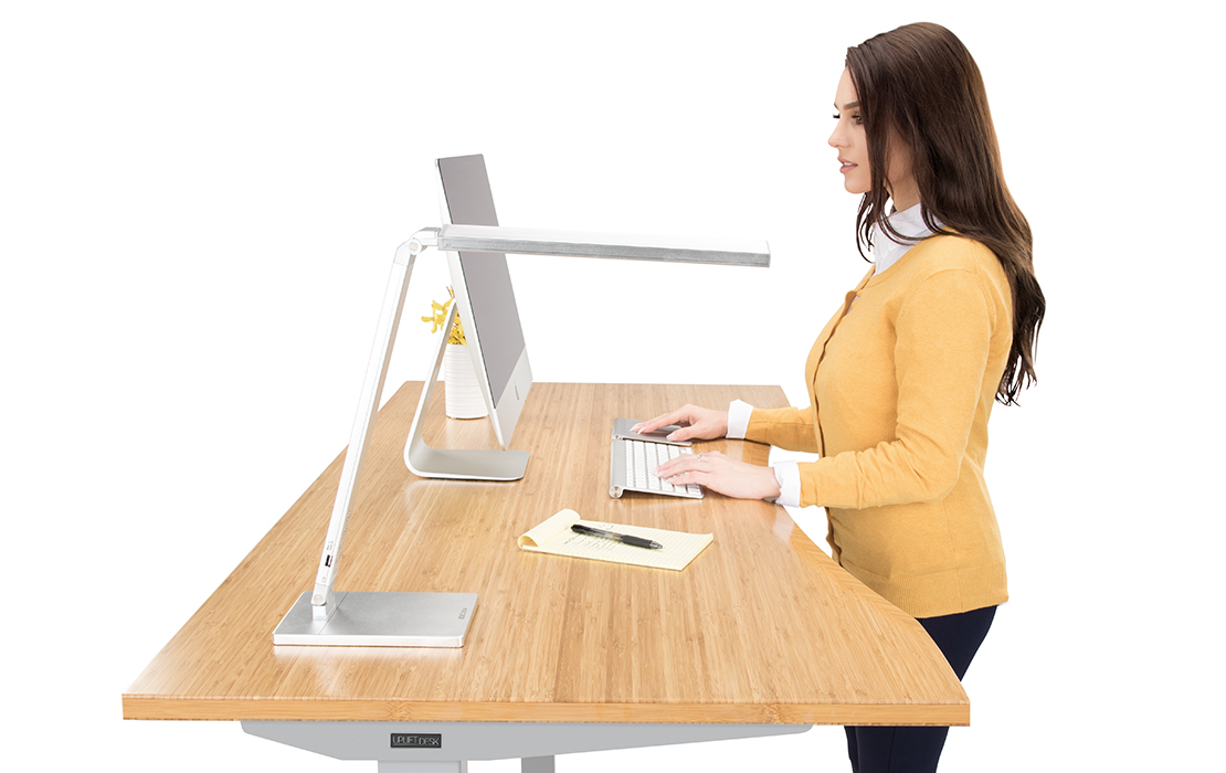 Standing At An UPLIFT Height Adjustable Desk
