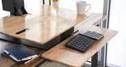 A tiered keyboard tray keeps your arms, wrists, and hands comfy at the keys (Natural Rubberwood desktop shown here)