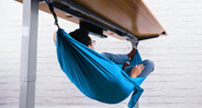 Catch up on rest during breaks between work with the Under Desk Hammock by UPLIFT Desk.