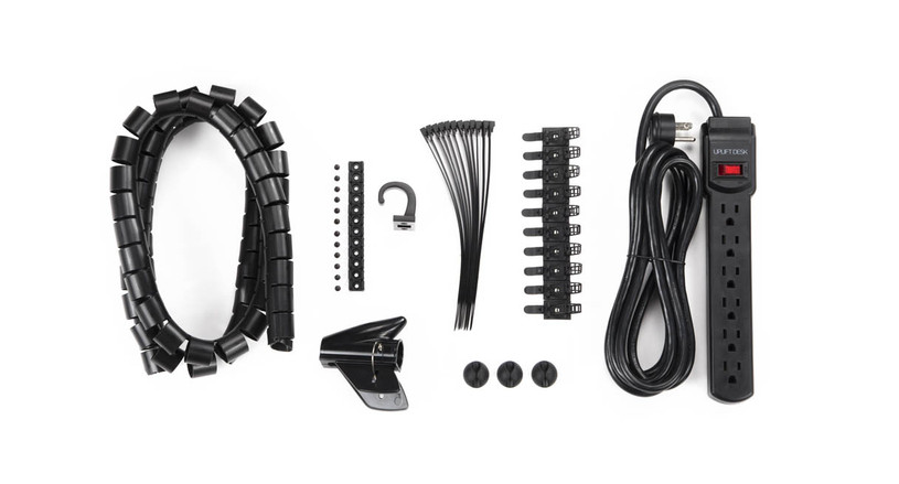 Kit comes with a basic surge protector, 12 screw-in cable mounts, 12 reusable cable ties, 10 adhesive cable mounts, 3 cable management clips, cable organizer, accessory hook, and hardware