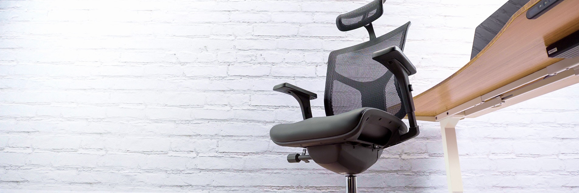 An ergonomic chair at a stand up desk