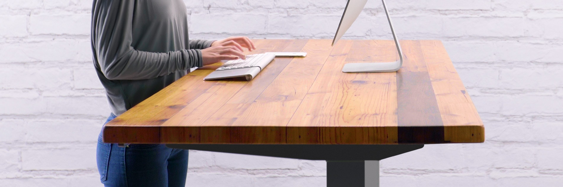 A custom wood sit stand desk and desktop