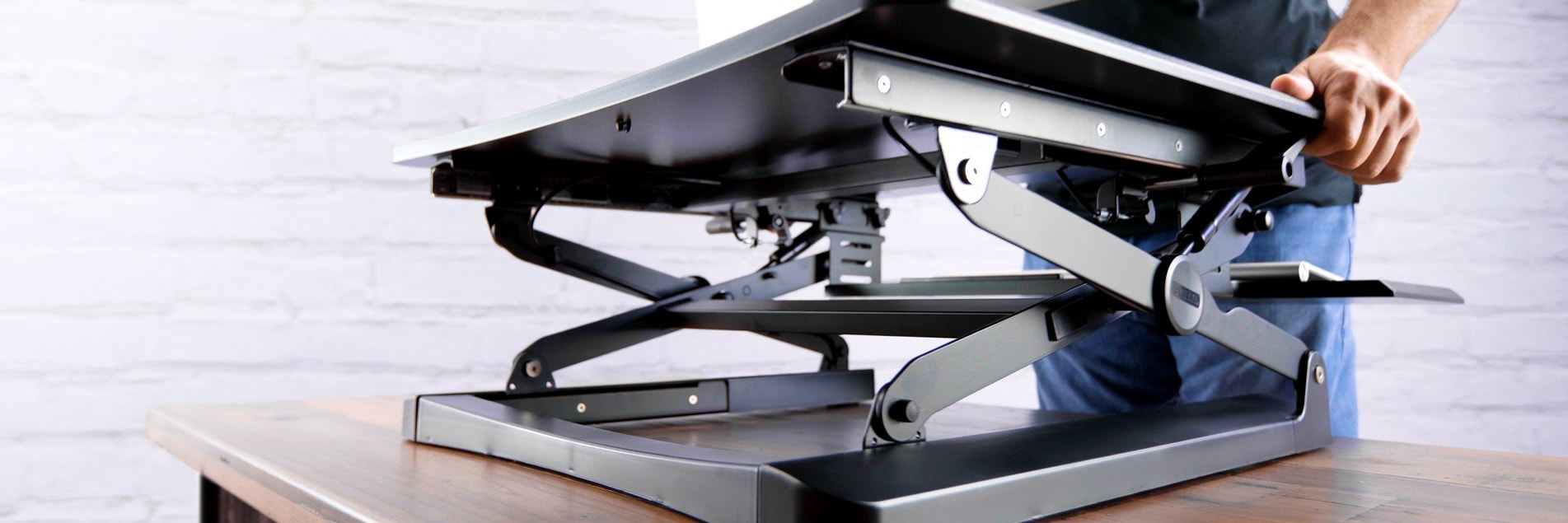 Standing desk converters work with your current setup