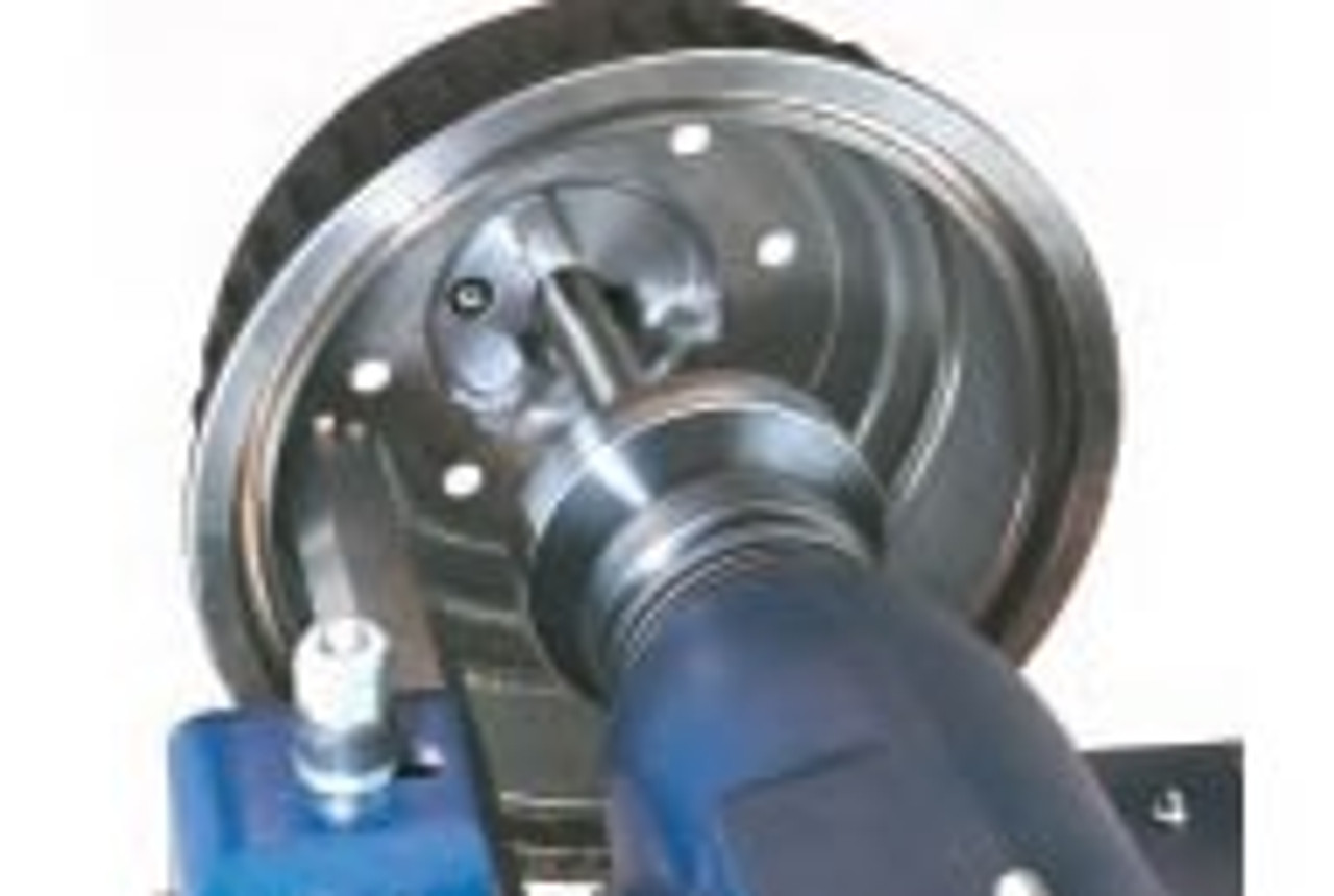 Hub-less drum mounted on an Ammco Brake Lathe with a 3-jaw Chuck.