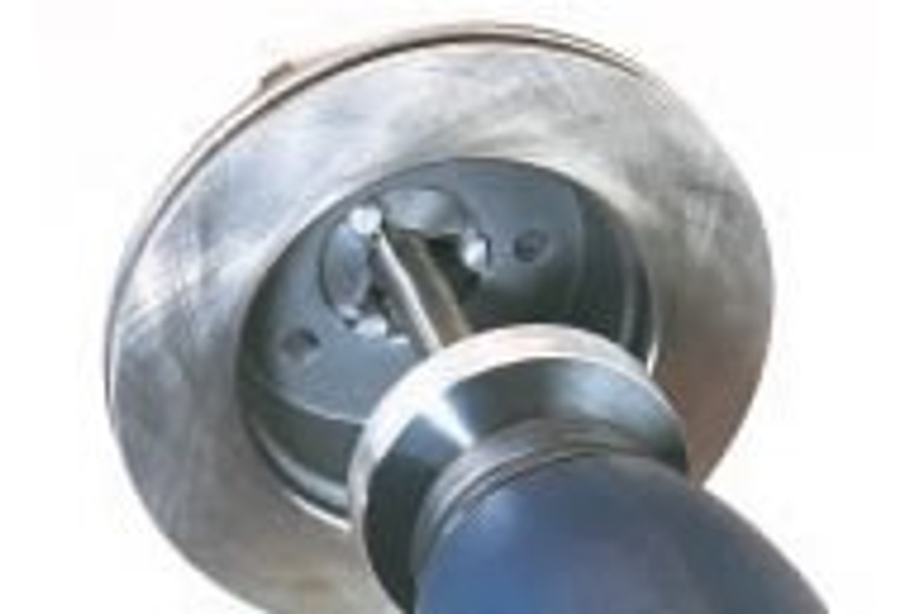 Hub-less rotor mounted on an Ammco Brake Lathe with a 3-jaw Chuck.