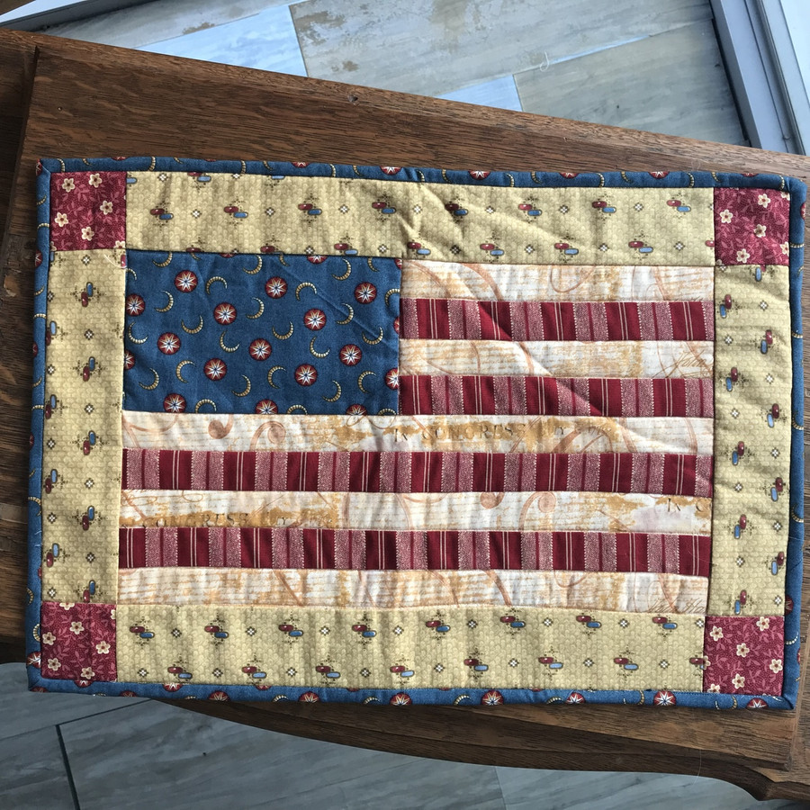 Pieced interpretation of the flag. Cotton fabric and cotton batting. Machine sewn.