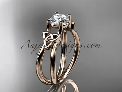 """14kt rose gold celtic trinity knot wedding ring, engagement ring with a """"Forever One"""" Moissanite center stone CT7130"""