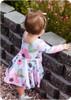 Long sleeves, scoop back, knee-length twirl skirt