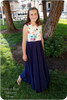 Sleeveless with flutters, maxi length twirl skirt