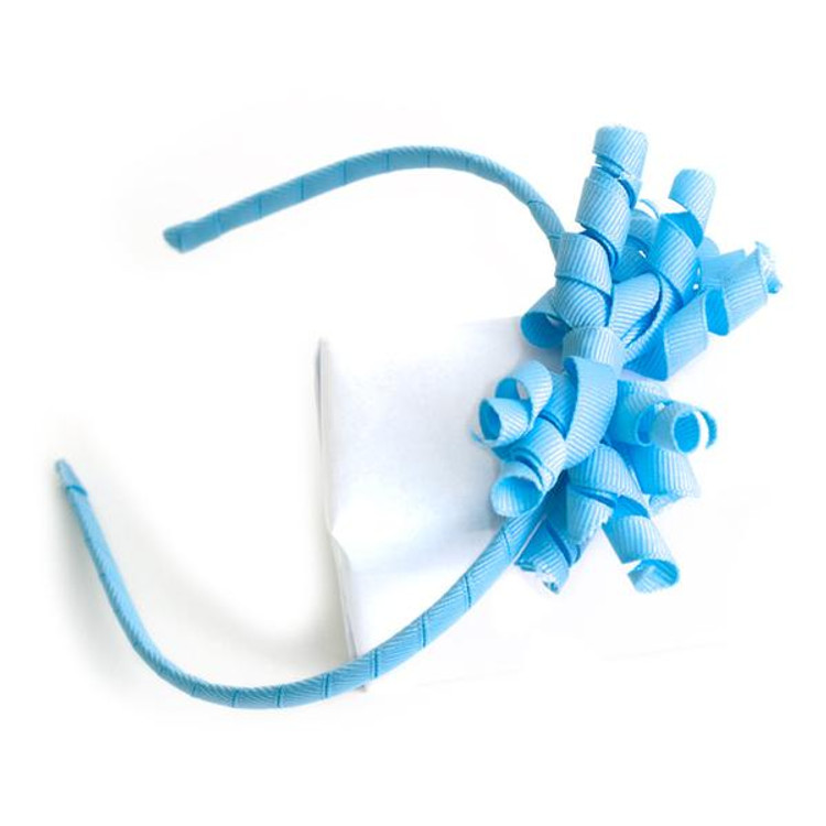 """These 1/4"""" headbands are adorned with a solid color ribbon, then we attach a matching solid and/or patterned ribbon Twiddle for a punch of fun.  Overall width is approximately 4"""" and approximately 6-7"""" high.  This size works best for toddler and little girls."""
