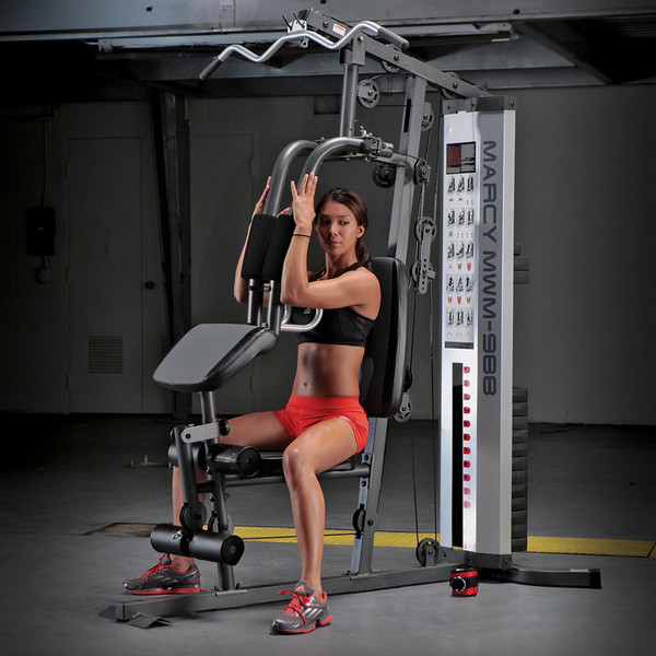 Model using Butterfly on the Marcy 150 Lb Weight Stack Home Gym - MWM-988