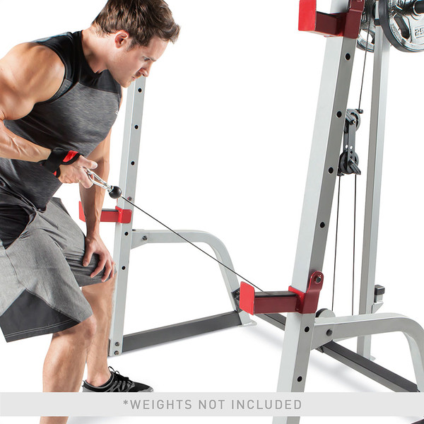 The Marcy Deluxe Smith Cage System with Bench MD-8851R in use - single arm rows