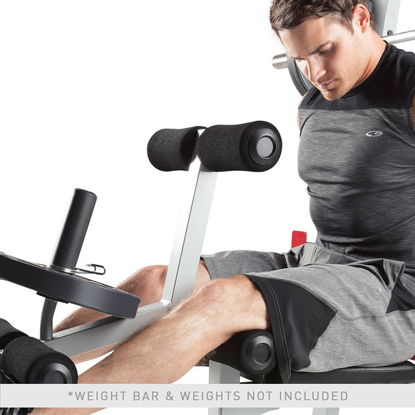 The Marcy Deluxe Smith Cage System with Bench MD-8851R in use - leg extensions