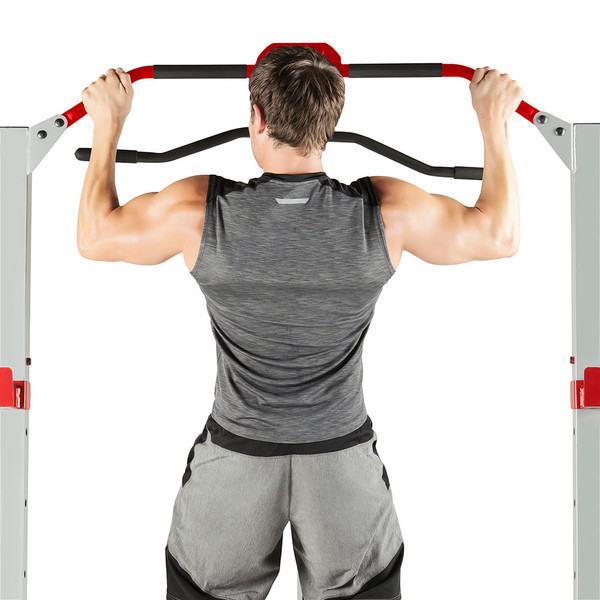 The Marcy Deluxe Smith Cage System with Bench MD-8851R in use - pull ups