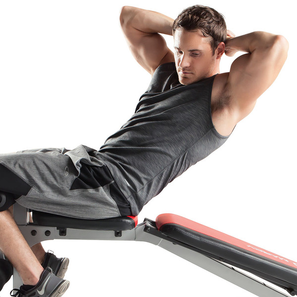 The Marcy Deluxe Smith Cage System with Bench MD-8851R in use - declined sit ups