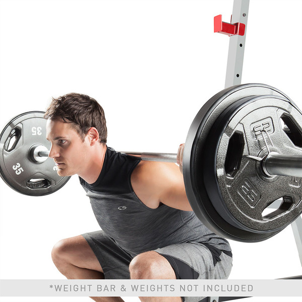 The Marcy Deluxe Smith Cage System with Bench MD-8851R in use - squats