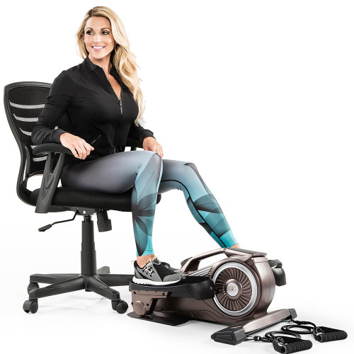 Superieur Bionic Body Compact Elliptical Trainer With Resistance Tubes In Use By Kim  Lyons While Sitting