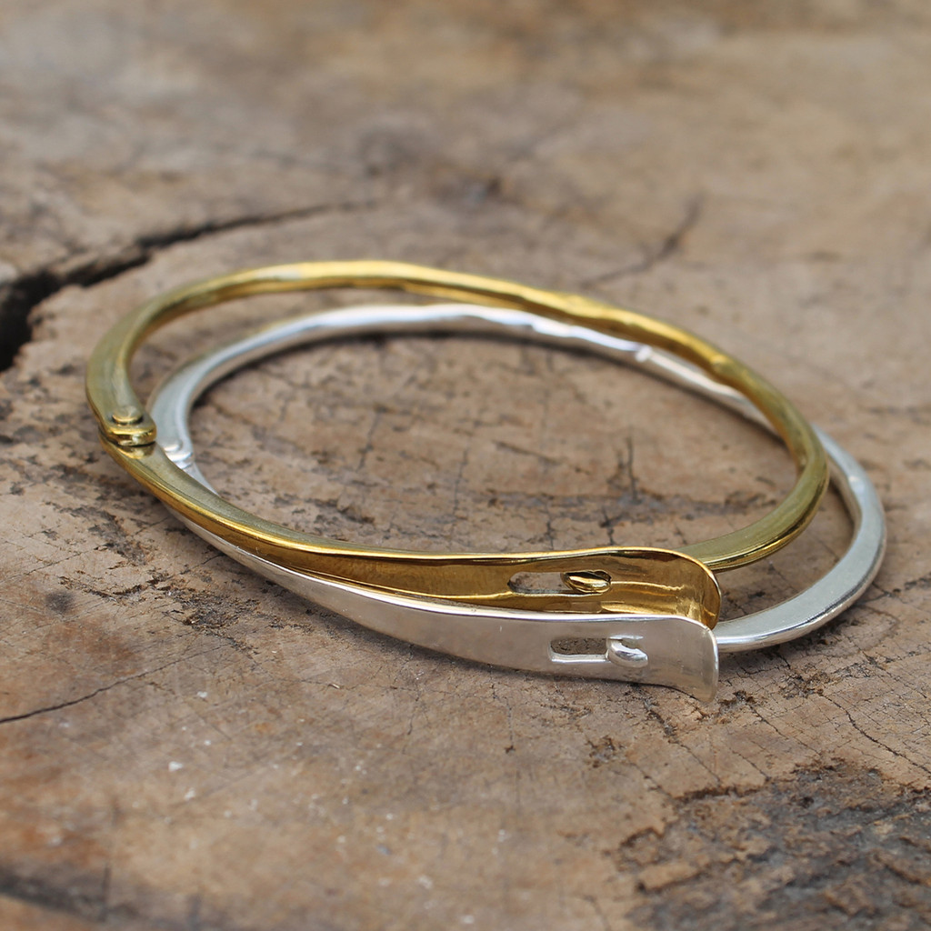 delicate silver and brass hinged cuffs