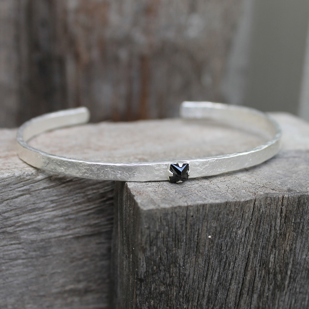 textured silver adjustable cuff with black stone