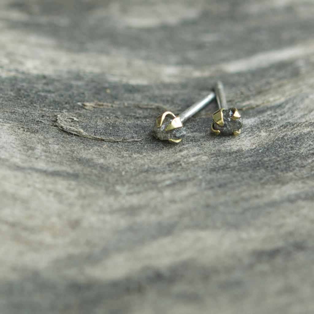 Raw diamond studs with oversized brass claws