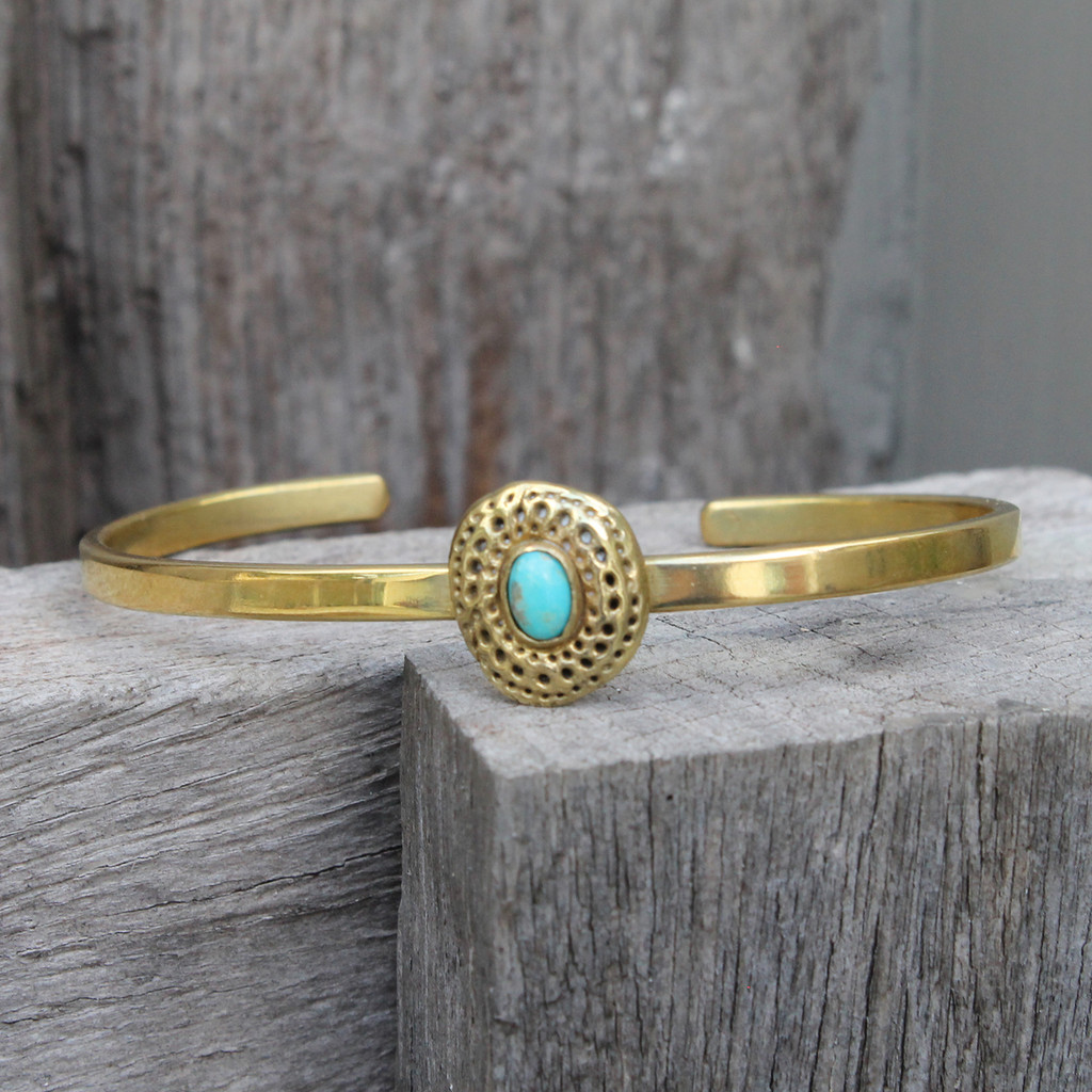 adjustable brass bracelet with turquoise stone detailing