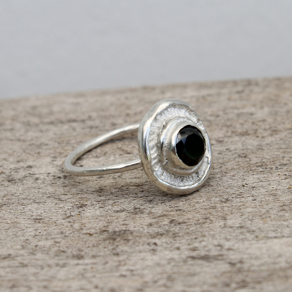 sterling silver ring with black stone detailing