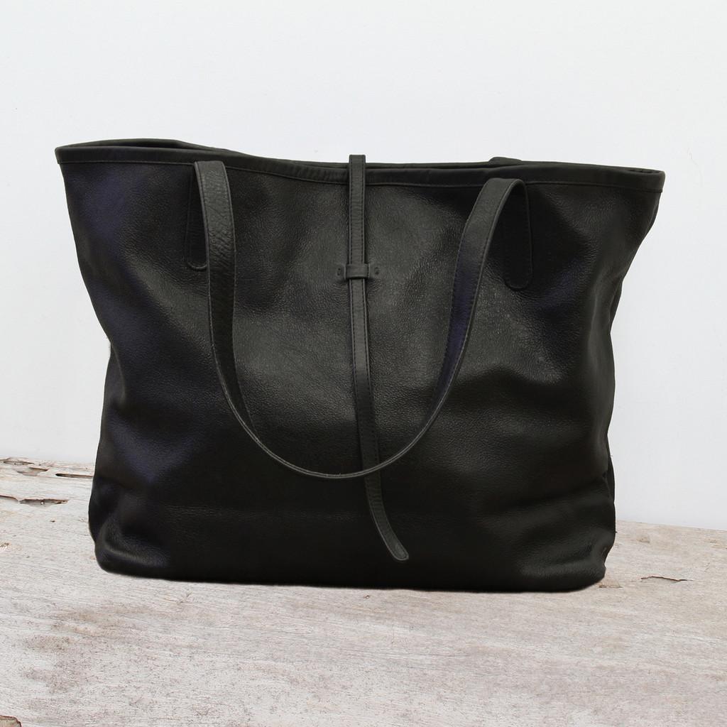 black leather tote bag with minimalist closure