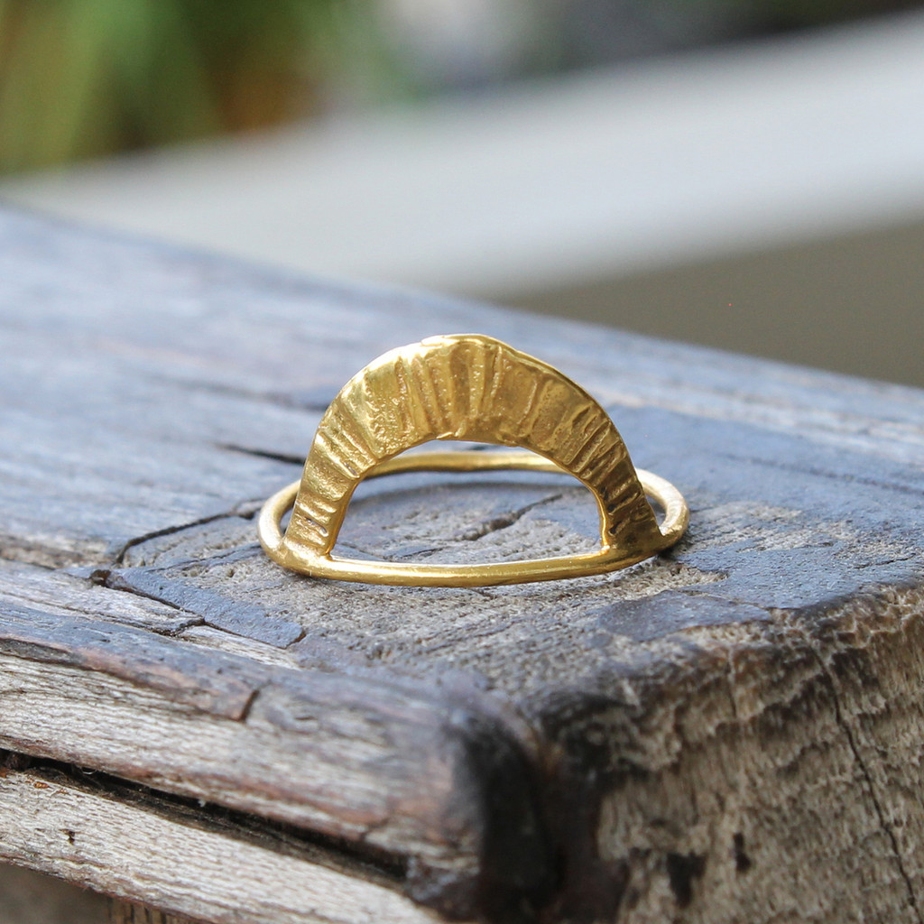 A tall arc ring with radial texture can be worn in either direction in 14 carat gold plated sterling silver.