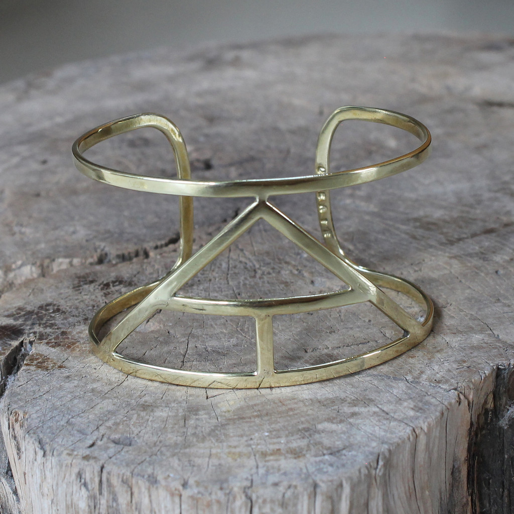 brass statement cuff featuring Create glyph symbol