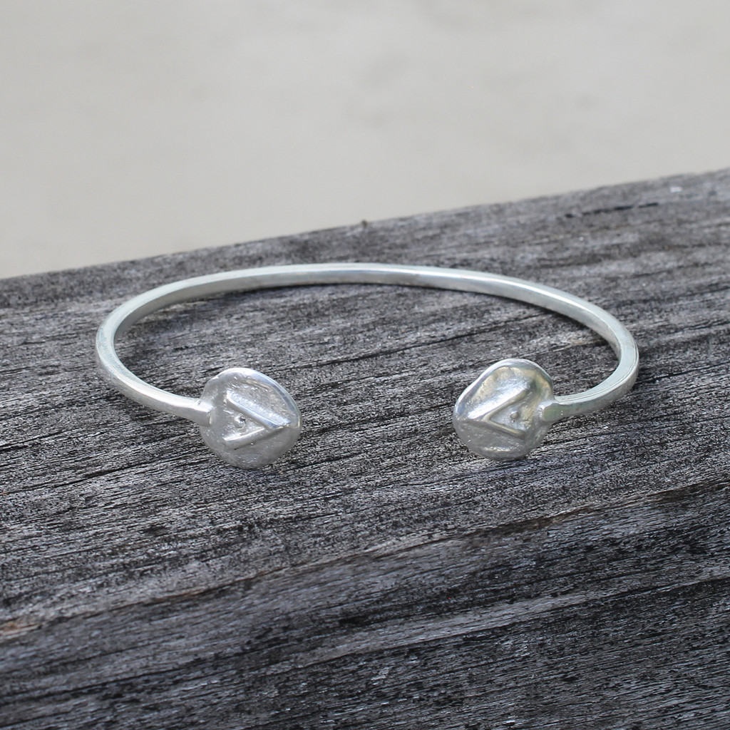 adjustable silver bracelet featuring Protect glyph symbol