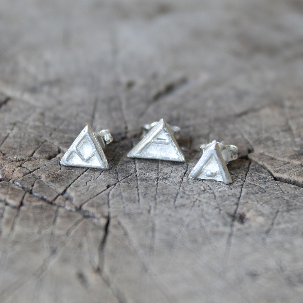 'transition', 'explore' and 'protect' glyph silver stud earrings