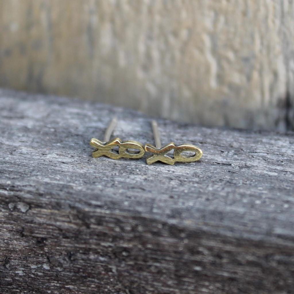 Brass XO earrings on a sterling silver post