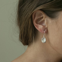 Oval shaped, textured silver drop earrings with sterling silver posts