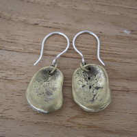 Oval shaped, textured brass drop earrings with sterling silver posts