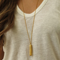 Talisman pendant in gold on a long chain (holds a small item)