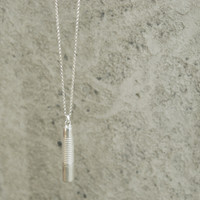 Talisman pendant in silver on a long chain (holds a small item)