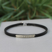 Black leather bracelet with silver STRENGTH detail